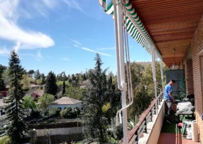 Toldo porta con postes para terraza